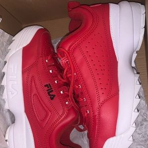 RED FILAS SIZE 7 IN WOMANS.